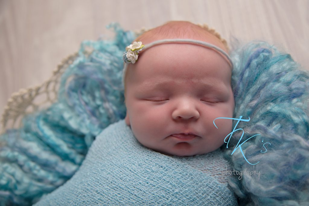 TK's Photography Launceston baby girl in blue close up