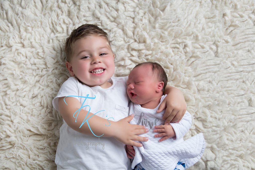 TK's Photography Launceston big brother newborn baby girl cuddles