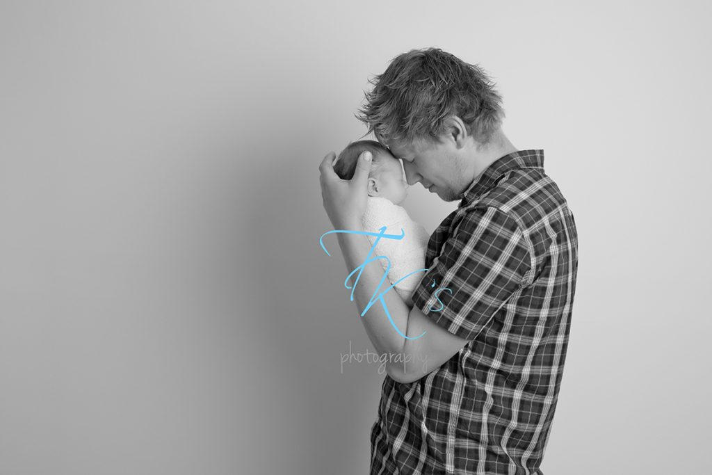 newborn baby girl black and white dad holding daughter nose to nose Launceston photographer