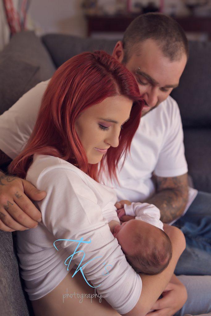 parents breastfeeding newborn girl Launceston photographer