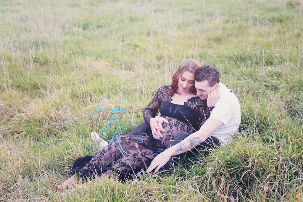 mum and did cuddling in long grass with hands on pregnant belly tattoos maternity Launceston