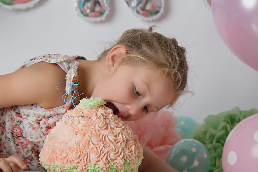 big sister eating cake