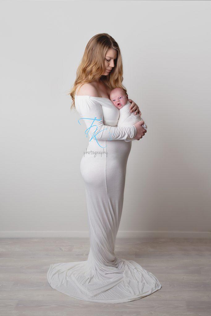 mum holding newborn baby boy
